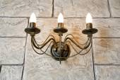 Brick wall chandelier in style of candlestick — Stock Photo