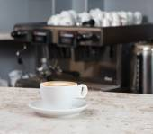 Cup of coffee on the bar — Stock Photo
