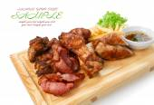 Restaurant food isolated - grilled meat assortment served on woo — Stock Photo