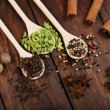 Variety of spices in wooden spoons — Stock Photo #67905919