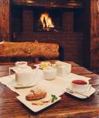 Romantic breakfast for two near fireplace — Stock Photo