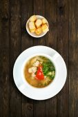 Restaurant food - white fish soup with croutons — Stock Photo