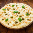 Delicious seafood pizza with olives — Stock Photo #77736980