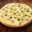 Delicious seafood pizza with olives — Stock Photo #77737024