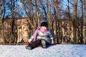 Little girl playing outdoors in winter — Stock Photo