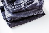 Clothes folded exactly in the stack — Stock Photo