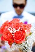 Bouquet in groom hand — Stock Photo