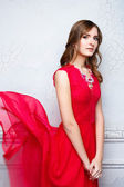 Woman in fluttering red dress — Stock Photo