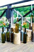 A candle in a bottle on wooden table — Stock Photo