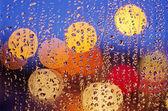 Night city life through  windscreen: darkness and rain — Stock Photo