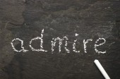 The word admire written with chalk on black stone. — Stock Photo