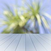 Empty wooden blue table with palms background. Ready for product display montage. — Stock Photo