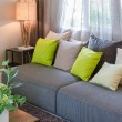 Grey sofa and green pillows in living room  — Stock Photo #61707613
