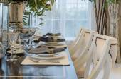 Luxury dinning room with table set on wooden table at home — Stock fotografie