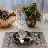 Earth tone table set with flower in dinning room — Stock Photo