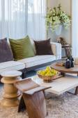 Living room with wooden furniture and flower — Stockfoto