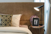 Single bed with lamp on table in bedroom — ストック写真
