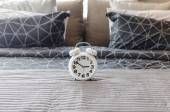 White alarm clock in bedroom — Stock Photo