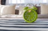 Modern green alarm clock in bedroom — Foto de Stock