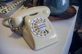 Retro photo of classic telephone on desk — ストック写真