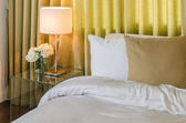 Bedroom with green curtain — Stock Photo
