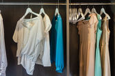 Dress hang in wooden wardrobe  — Stock Photo