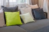 Grey sofa with green pillows in living room at home — Stock Photo