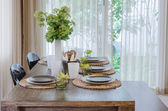 Modern dinning room with wooden table and chair — Stock Photo