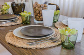 Table set on wooden table in dinning room at home — Stock Photo