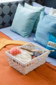 Basket of crochet on colorful bed in bedroom — Stock Photo
