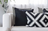 Black and white pattern pillows on white sofa at home — 图库照片