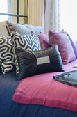 Multicolor pillows on bed in bedroom design — Foto de Stock