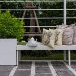 Tea set and yellow pillows on white wodden bench — Stock Photo #61715445