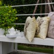 Tea set and pillows on white bench — Stock Photo #61717863