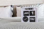 Modern alarm clock on bed — Stock Photo