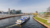 View of the Berlin Hauptbahnhof station building with boat — Stock Photo
