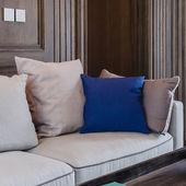 Blue pillow on modern sofa — Stock Photo