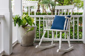 White wooden rocking chair on front porch at home — Stock Photo