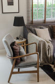 Modern wood chair with pillow in modern living room — Stock Photo