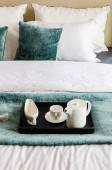 Tea set on black tray in modern bedroom — Stock Photo