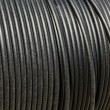Black electrical cable wound up — Stock Photo #61724467