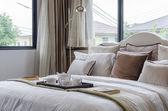 Luxury bedroom with tray of white tea set  — Stock Photo