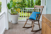 Wooden rocking chair on front porch — Stock Photo