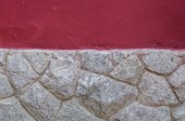 Rock wall with red texture wall — Stockfoto