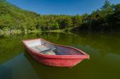 Red boat in lake and reflection — Stock Photo