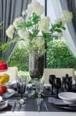 Flower in glass vase on dinnig table — Stock Photo