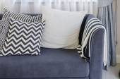 Black and white pillows on blue sofa in living room — Stock Photo