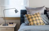 Modern bedroom with modern grey lamp on table — Stock Photo