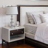 Luxury bedroom with white classic lamp and clock on table  — ストック写真