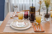 Dinning set on wooden table in modern dinning room — Stock Photo